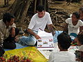 Australian volunteer Aaron Watson explains HIVAIDS and how it is transmitted. Cambodia 2010. Photo- AusAID (10675132305).jpg