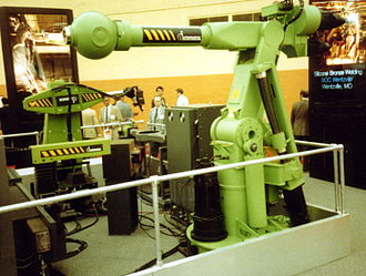 Automatix - Automatix robots at the Robots '85 trade show in Detroit, Michigan. Clockwise from lower left: AID 600, AID 900 Seamtracker, Yaskawa Motoman.