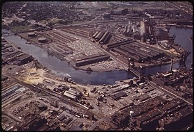 Color image of a heavy industrial district abutting a winding river