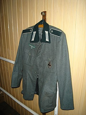 Enlisted infantryman's M36 uniform. Note the dark-green collar and shoulder-straps (with white Waffenfarbe), the Litzen collar insignia, and the Wehrmachtsadler above the right breast pocket. - World War II German uniform