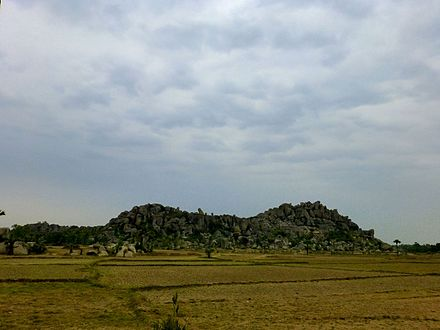 Barabar Caves - Rock Piled Landscape (9227681334).jpg