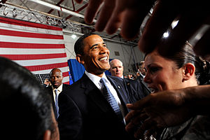 President Barack Obama greets Nellis Airmen an...