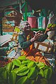 Beautiful old woman selling fruits.jpg