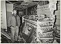 Bedrijfsleider E. Hellbeck van speelgoedwinkel Intertoys staat na de brand, tussen de enorme ravage in zijn winkel. NL-HlmNHA 54031520.JPG