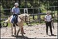 Benjamin receiving riding lesson-1 (29557906704).jpg