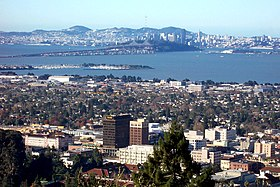 Downtown Berkeley viewed from the Berkeley Hills in December 2005, with the San Francisco-Oakland Bay Bridge and San Francisco in the background