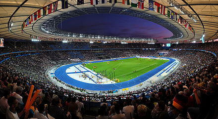The Olympiastadion hosted the 1936 Summer Olympics and the 2006 FIFA World Cup Final. Berliner Olympiastadion night 2.jpg