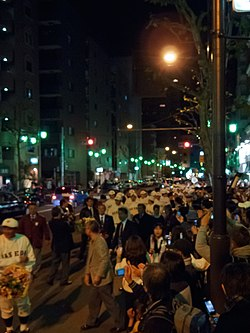 Waseda Victory parade in 2010 showing the players and a crowd of by-standers