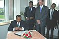 Biya signs guest book.JPG