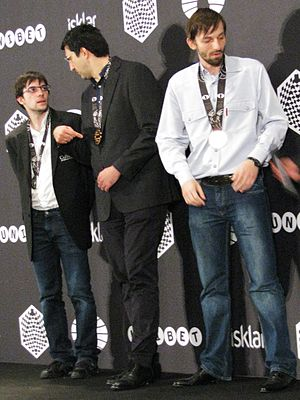 Fast chess - Blitz World Champion Alexander Grischuk (right) in Berlin, 2015. With runners-up  Vladimir Kramnik (center) and Maxime Vachier-Lagrave (left).