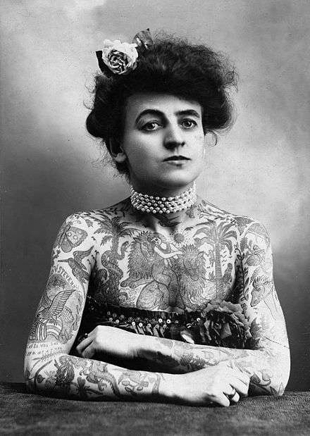 Mrs. M. Stevens Wagner with arms and chest covered in tattoos Body art, 1907 black n white.jpg