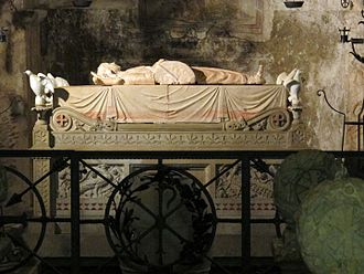 Basilica of Santa Cristina, Bolsena - The Tomb of St Cristina with Buglioni sculpture in the center the statue illustrates the stone used in the attempt to drown her.