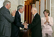 President George W. Bush along with House Majority Leader Steny Hoyer and House Speaker Nancy Pelosi congratulate Borlaug during the Congressional Gold Medal Ceremony on July 17, 2007