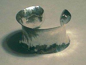 Raising (metalworking) - Anticlastic forged sterling bracelet.