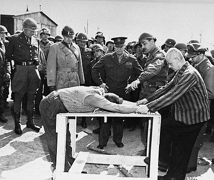 Survivors of the Ohrdruf concentration camp demonstrate torture methods used in the camp Buchenwald Eisenhower torture demonstration 63511.jpg
