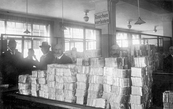 Piles of new Notgeld banknotes awaiting distribution at the Reichsbank, during the hyperinflation. Bundesarchiv Bild 183-R1215-506, Berlin, Reichsbank, Geldauflieferungsstelle.jpg