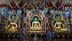 Golden statues of Gautama Buddha, Padmasambhava and Amitāyus