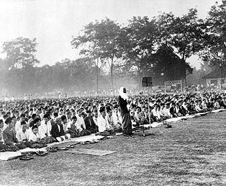 Lebaran - Eid mass prayer on open field during colonial Dutch East Indies period.