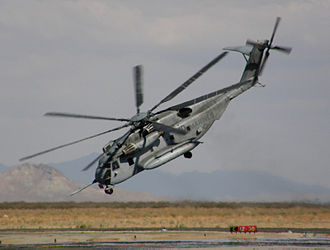 Sikorsky CH-53E Super Stallion - A production CH-53E during flight demonstration showing the three engines and the tail rotor pylon