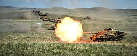 A row of Challenger 2 on a firing range at BATUS, Canada