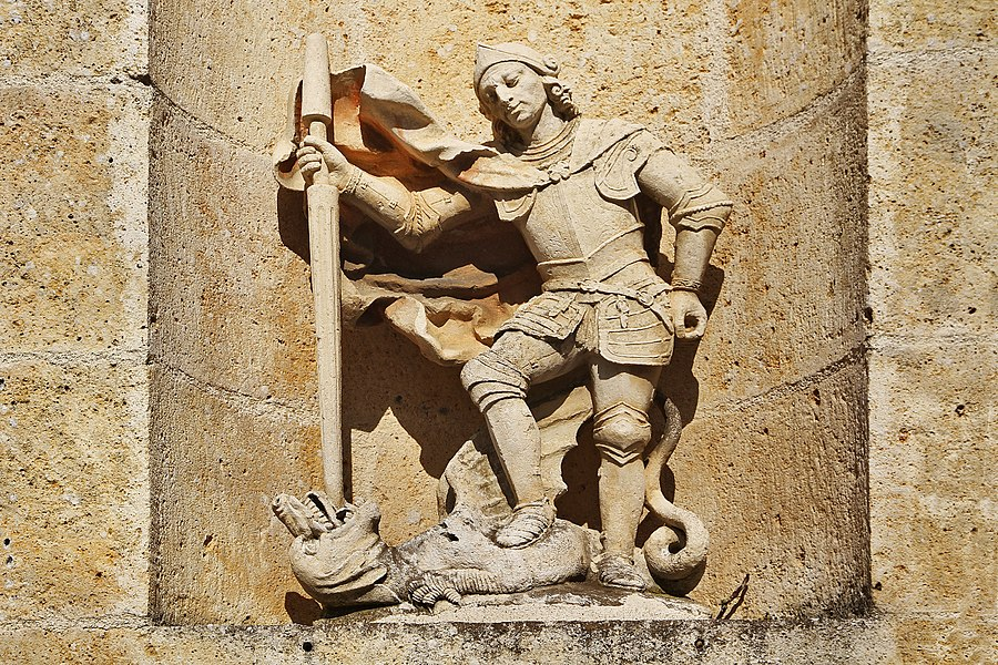 Statue of St George fighting the dragon on the church of Chaugey