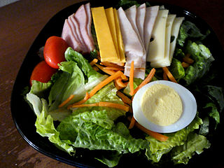 Chef salad U.S. salad consisting of items such as hard-boiled eggs, one or more varieties of meat (e.g. ham, turkey, chicken, roast beef), tomatoes, cucumbers, and/or cheese, placed upon a bed of tossed lettuce or other leaf vegetables; a variety of dressings may be used