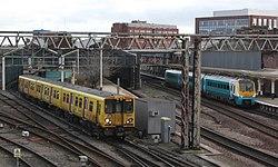 Chester - Merseyrail 508108 and Keolis Amey 175109.JPG