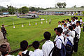 "Children watch two SH-60F Seahawk helicopters assigned to the ""Black Knights"" of Helicopter Anti-Submarine Squadron 4 land in a football field outside their school in Altavas, Philippines, June 30 080630-N-HX866-013.jpg"