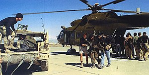 Operation Anaconda - US Special Forces help Northern Alliance troops away from a CIA-operated MI-17 Hip helicopter at Bagram Airbase