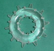 A clear, soft plastic ring with knobs