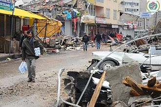 2011 Van earthquakes - Collapsed structures and damaged car in Van almost a week after the earthquake