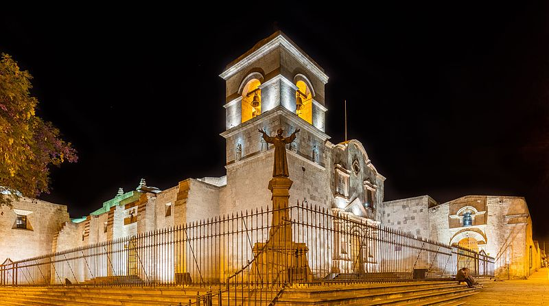 Franciscan Monastery, Peru.  Stone building lit up against black night sky.  Complejo San Francisco, Arequipa, Perú.
