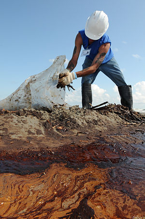 Corexit - A worker cleans up oily waste on Elmer's Island, Louisiana, on May 21, 2010