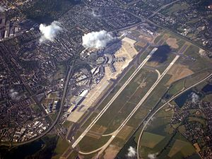 Düsseldorf Airport station - Aerial view of the airport; the station is visible on the bottom left end of the runway
