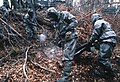 DA-ST-90-10925 German soldiers wearing full Nuclear-Biological-Chemical (NBC) protective suits and masks in 1990.jpeg