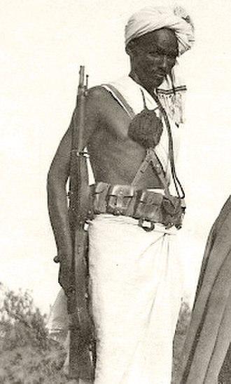 Dubats - Dubat with rifle, futa and lanyard in Eritrea during the Second Italo-Abyssinian War.