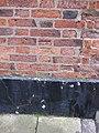 Damaged bench mark on ^49 Highgate - geograph.org.uk - 2256567.jpg