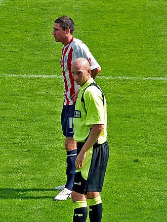 Danny Whitaker - Whitaker (in green) playing for Oldham Athletic