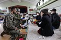 Defense.gov News Photo 110323-M-KA277-002 - U.S. Marine Corps Capt. Vieet Rajan left with III Marine Expeditionary Force speaks with survivors at a shelter facility inside Watariha.jpg