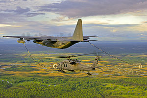 Defense.gov News Photo 120314-F-FC540-031 - An Alaska Air National Guard HC-130 aircraft and HH-60 Pave Hawk helicopter practice helicopter aerial refueling over Joint Base.jpg