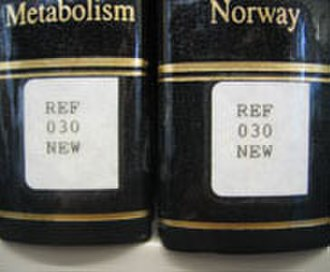 Melvil Dewey - Spine labels showing Dewey Decimal Classification call numbers.