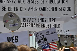 Mass surveillance - Germans protesting against the NSA surveillance program PRISM at Checkpoint Charlie in Berlin.