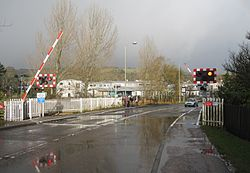 Dingwall Middle Level Crossing - barriers down (11119685323).jpg