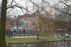Het Dolhuys - View of the complex from the park across the Singel