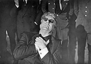 English: Dr. Strangelove trying to resist his ...