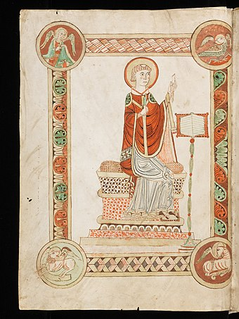 The Venerable Bede writing the Ecclesiastical History of the English People, from a codex at Engelberg Abbey in Switzerland. E-codices bke-0047 001v medium.jpg