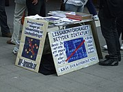 Members of the LaRouche movement in Stockholm protest the Treaty of Lisbon with pictures rearranging the stars of the Flag of Europe into a swastika.