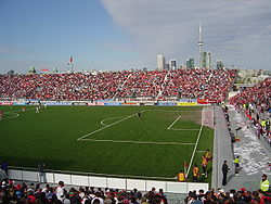 A packed BMO Field with the CN Tower to the east.