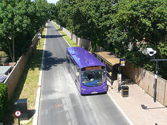 South East Hampshire Bus Rapid Transit - An Eclipse BRT bus calls at Gregson Avenue bus stop, as seen from the road bridge over the busway.
