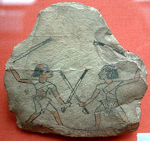 Tahtib - Image of two men practicing tahtib on an ostracon